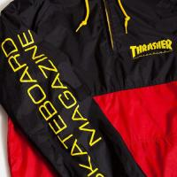 "THRASHER - スラッシャー ""ANOARK"" WIND HOOD (RED/YELLOW)"